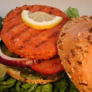 Salmon patties cooked fresh on toasted bun with onions, pickles, lettuce and lemon slice.